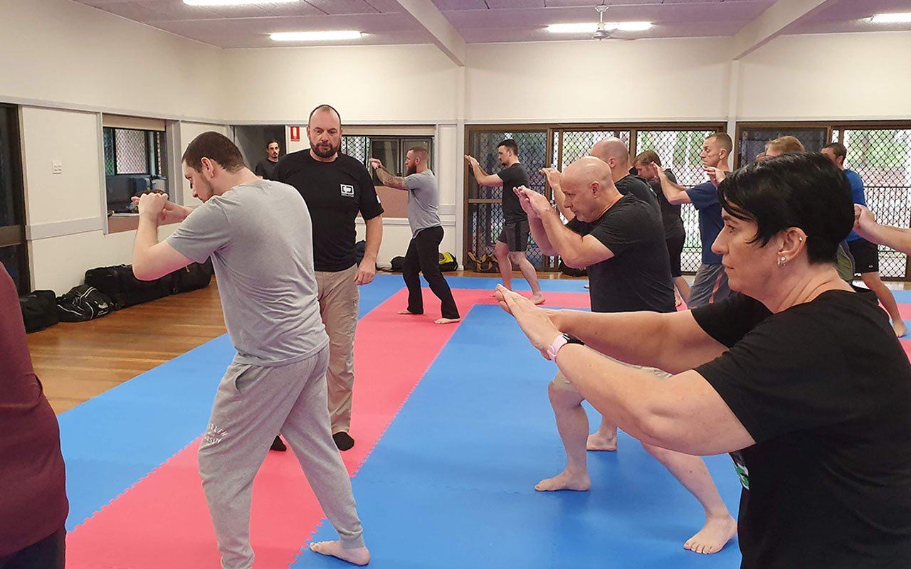 Beginners join the likes of Hanshi Bryson Keenan, 8th Degree karate black-belt (centre, in black T-shirt), on the KEF–IC course in Brisbane.