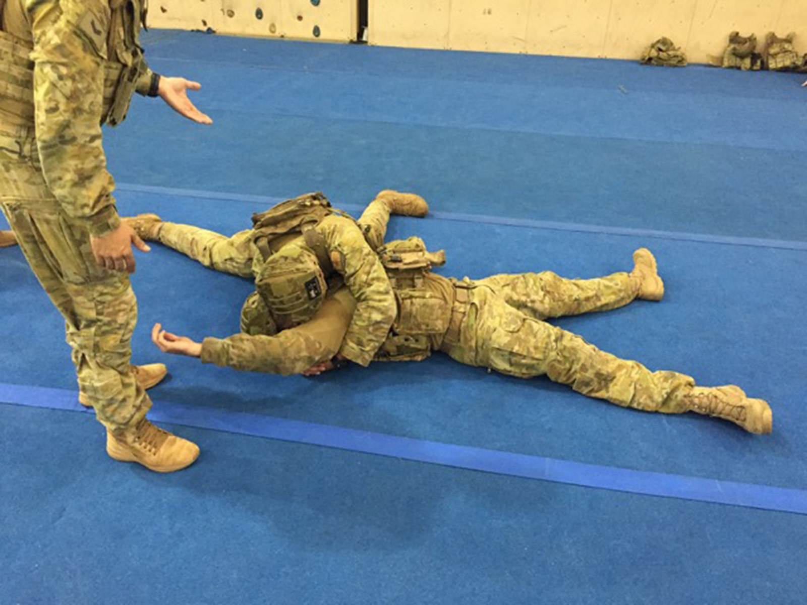 Soldier practising high-cross domination during ACP training