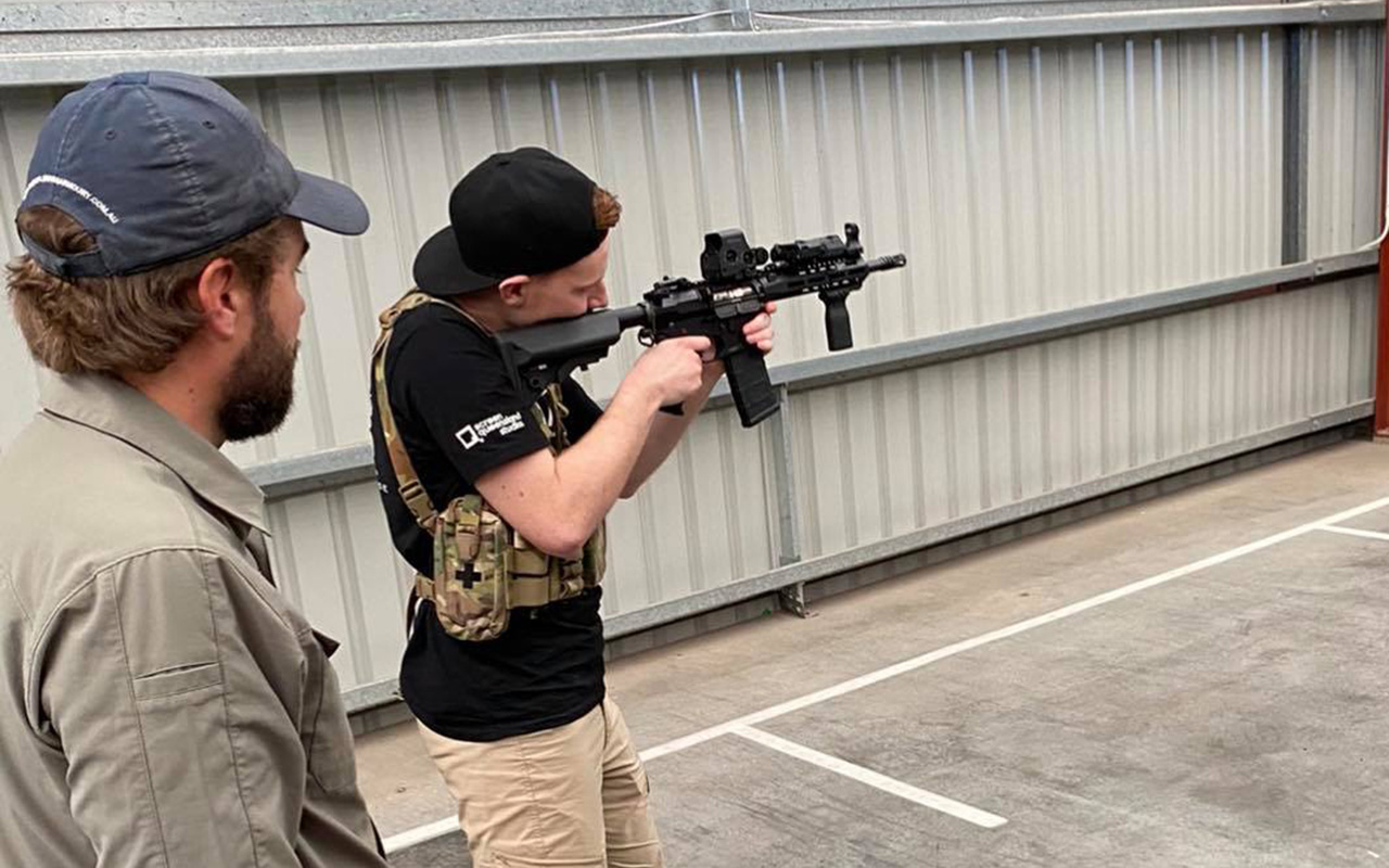 Screen Combat Safety student firing AR-15