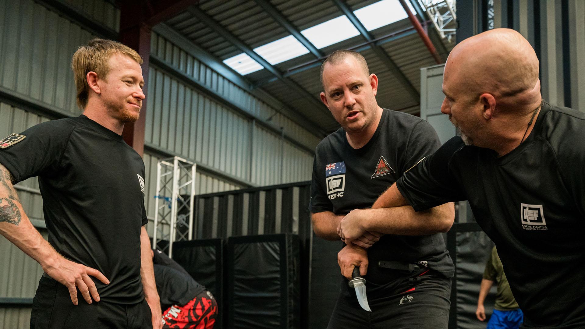 KEF–IC Instructor Geordie Lavers-McBain teaching knife defence