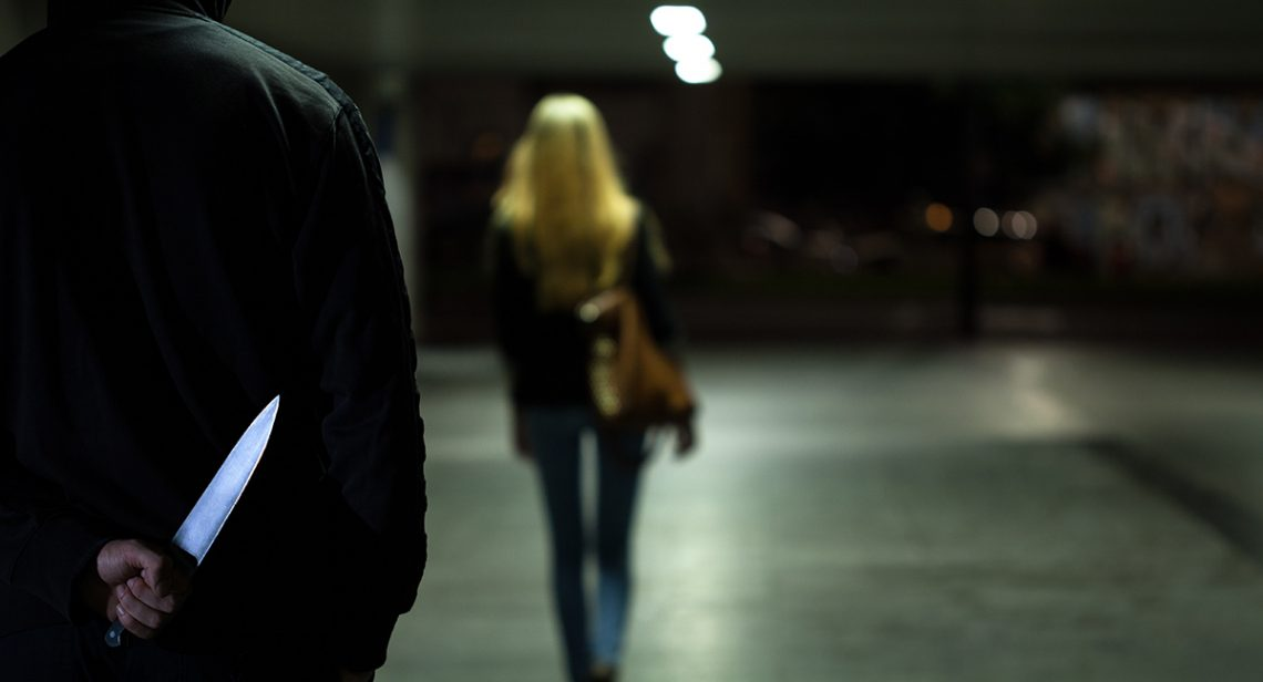 Indicators of violence: Man approaching woman in car park